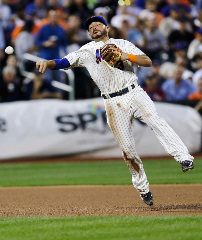 . New York Mets\' Omar Quintanilla throws out Colorado Rockies\' Charlie Blackmon at first base during the third inning of a baseball game Wednesday, Aug. 7, 2013, in New York. (AP Photo/Frank Franklin II)