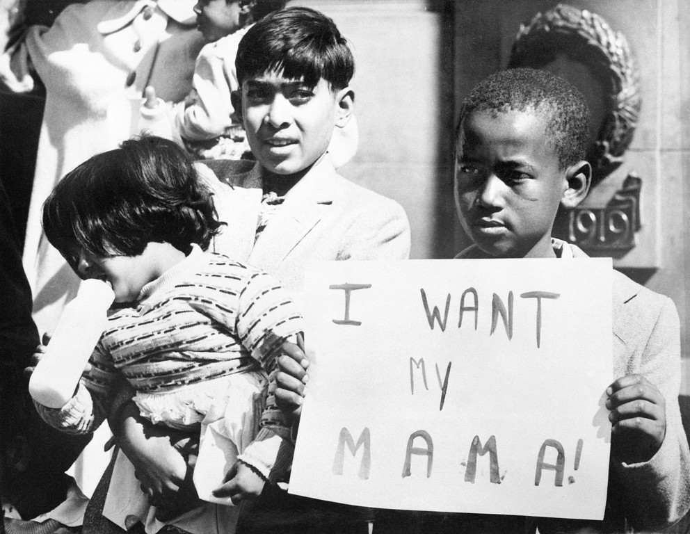 . A black child demonstrates to have his mother released, in May 1960 in front of Johannesburg\'s city hall. These last weeks, more than 500 native South Africans have been arrested, after the Sharpeville massacre, where at least 180 black Africans were injured and 69 killed when South African police opened fire on demonstrators, 21 March 1960. (OFF/AFP/Getty Images)