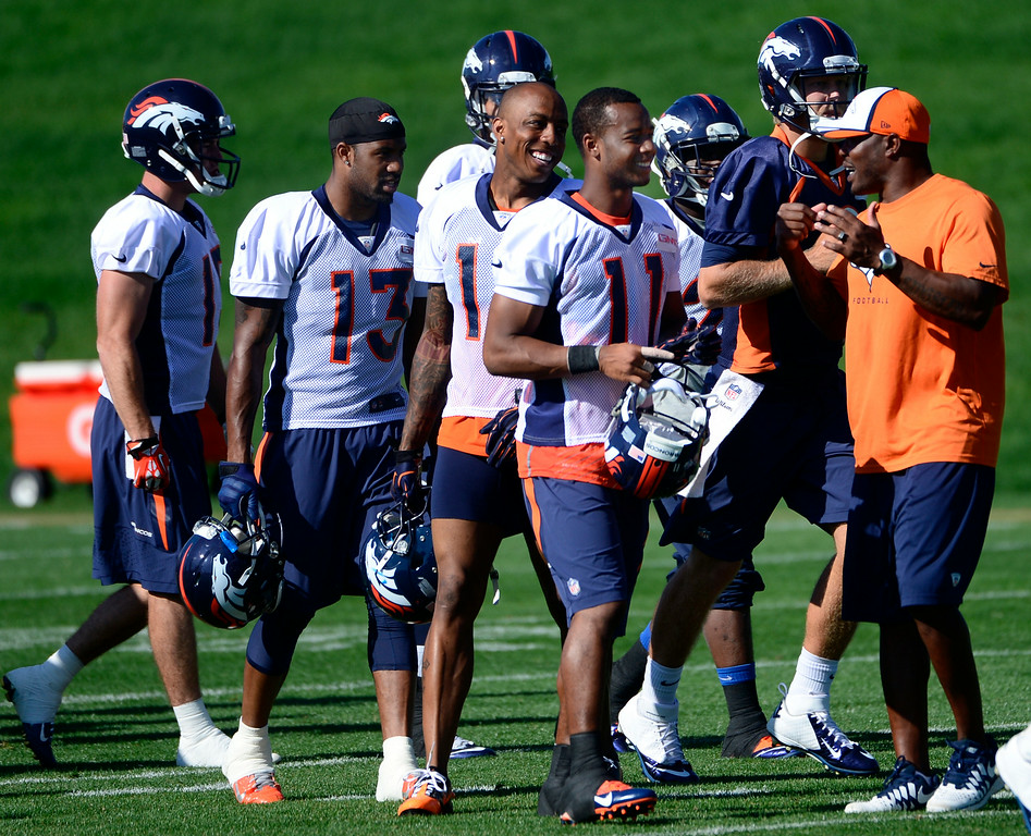 . Jordan Norwood (11) and other fellow wide receivers head to the practice field after stretching. The Denver Broncos football team gets in their final day of practice during training camp at Dove Valley  on Friday, Aug. 15, 2014. (Photo by Kathryn Scott Osler/The Denver Post)