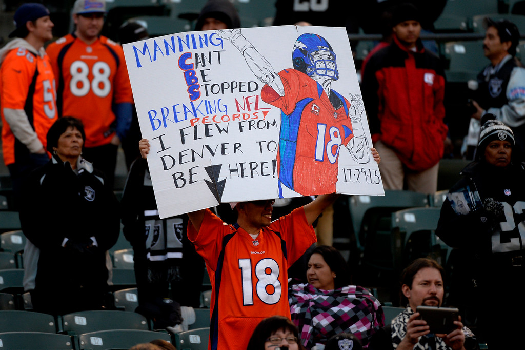 . Fans watch the game between the Denver Broncos and the Oakland Raiders at O.co Coliseum December 29, 2013 Oakland, Calif. Photo By Joe Amon/The Denver Post)