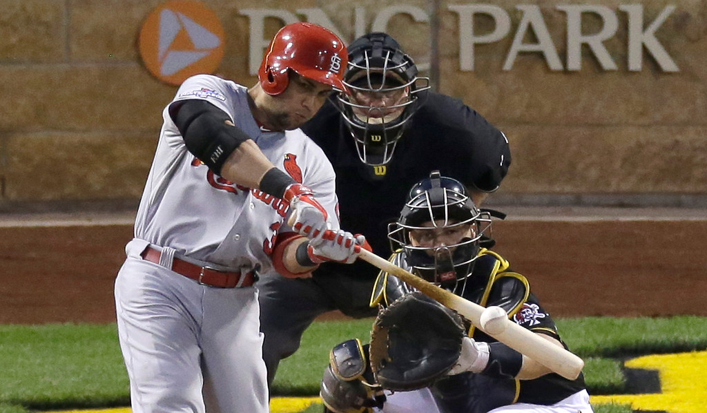 . St. Louis Cardinals\' Carlos Beltran hits a solo home run in the eighth inning of Game 3 of a National League baseball division series as Pittsburgh Pirates catcher Russell Martin looks on Sunday, Oct. 6, 2013, in Pittsburgh . (AP Photo/Tom Puskar)
