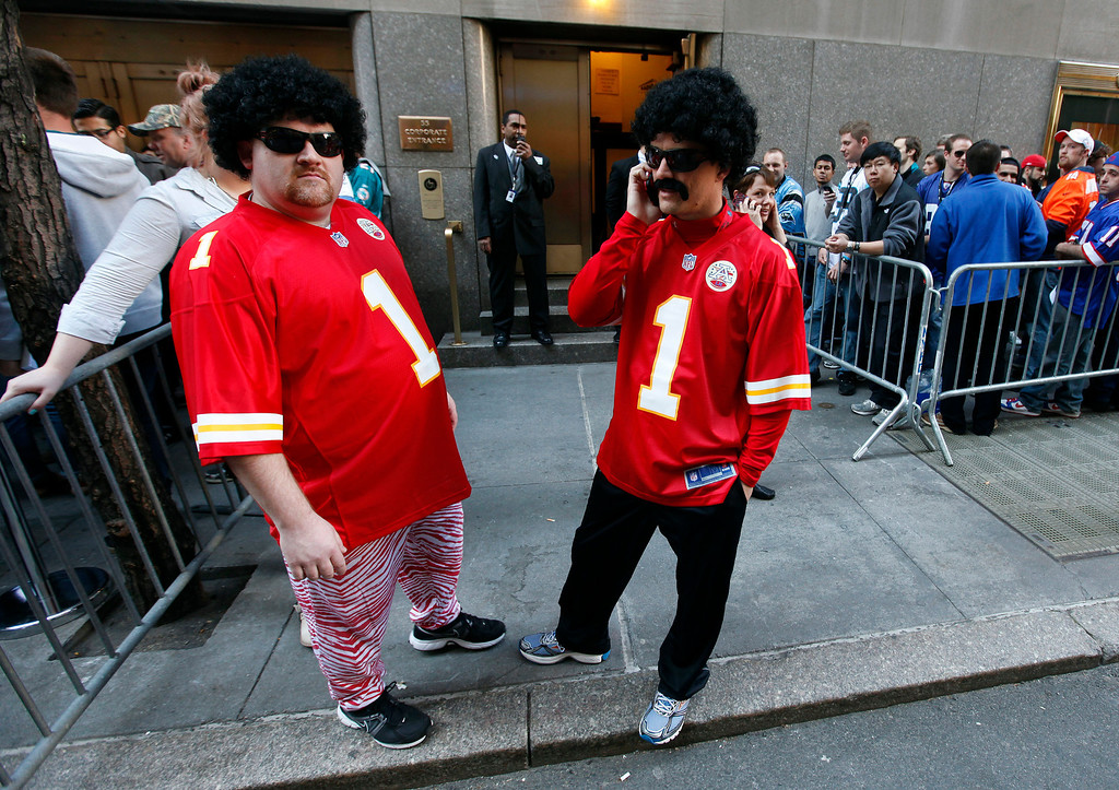 . Kansas City Chiefs fans Chad Comeau, left, of Pittsburg, Kan., and Chris Keller, of Joplin, Mo., are dressed as fictional football player Leon Sandcastle as they wait in line outside Radio City Music Hall before the first round of the NFL football draft on Thursday, April 25, 2013, in New York. (AP Photo/Jason DeCrow)