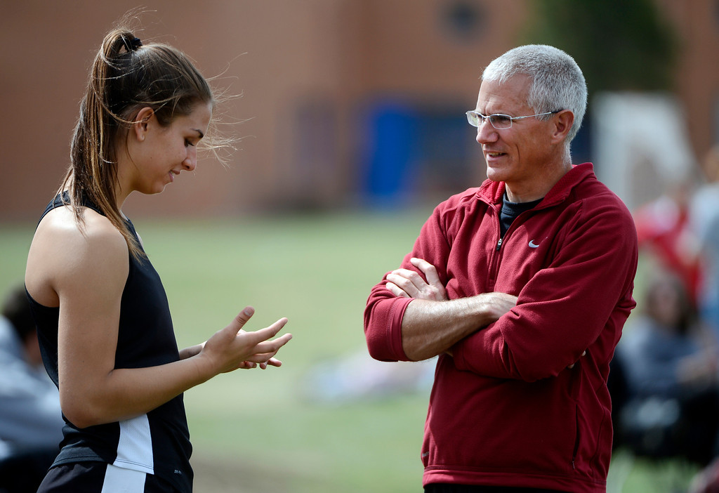 . DENVER, CO. - APRIL 13TH: Silver Creek High School track athlete, Valarie Allman, left, talks with coach, Brian Gunnarson, in between rounds during the girls discus throw competition at the Mullen Runners Roost 2013 Track and Field Invitational at Mullen High School, Saturday April, 13th 2013. (Photo By Andy Cross/The Denver Post)