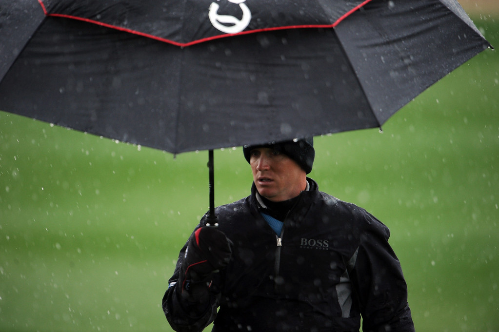 . MARANA, AZ - FEBRUARY 20:  Alex Noren of Sweden stands under an umbrella as snow and rain falls during the first round of the World Golf Championships - Accenture Match Play at the Golf Club at Dove Mountain on February 20, 2013 in Marana, Arizona. Play was suspended due to weather. (Photo by Stuart Franklin/Getty Images)