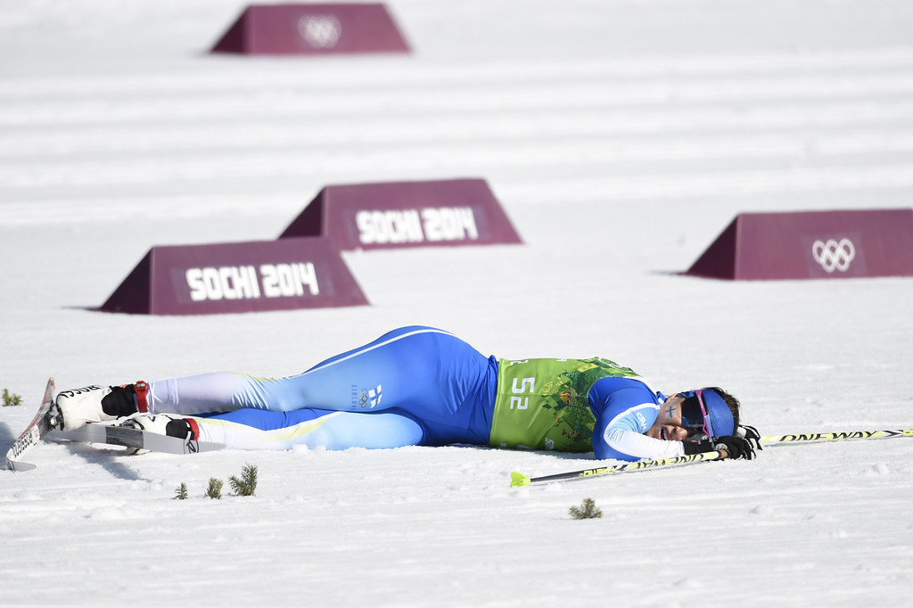 . Finland\'s Aino-Kaisa Saarinen falls to the ground after her relay-leg in the Women\'s Cross-Country Skiing 4x5km Relay at the Laura Cross-Country Ski and Biathlon Center during the Sochi Winter Olympics on February 15, 2014, in Rosa Khutor, near Sochi. ODD ANDERSEN/AFP/Getty Images