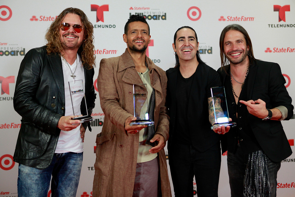 . Mana poses with their three awards at the Latin Billboard Awards in Coral Gables, Fla. Thursday, April 25, 2013. (Photo by Carlo Allegri/Invision/AP)