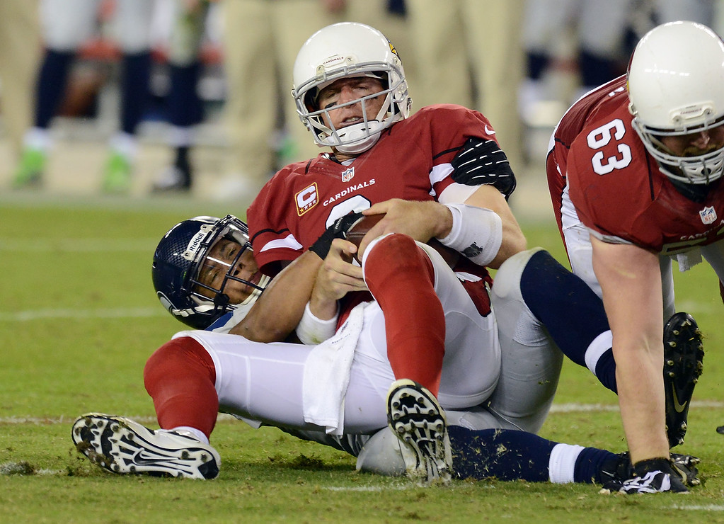 . GLENDALE, AZ - OCTOBER 17:  Malcolm Smith #53 of the Seattle Seahawks sacks Carson Palmer #3 of the Arizona Cardinals late in the second half at University of Phoenix Stadium on October 17, 2013 in Glendale, Arizona.  (Photo by Norm Hall/Getty Images)