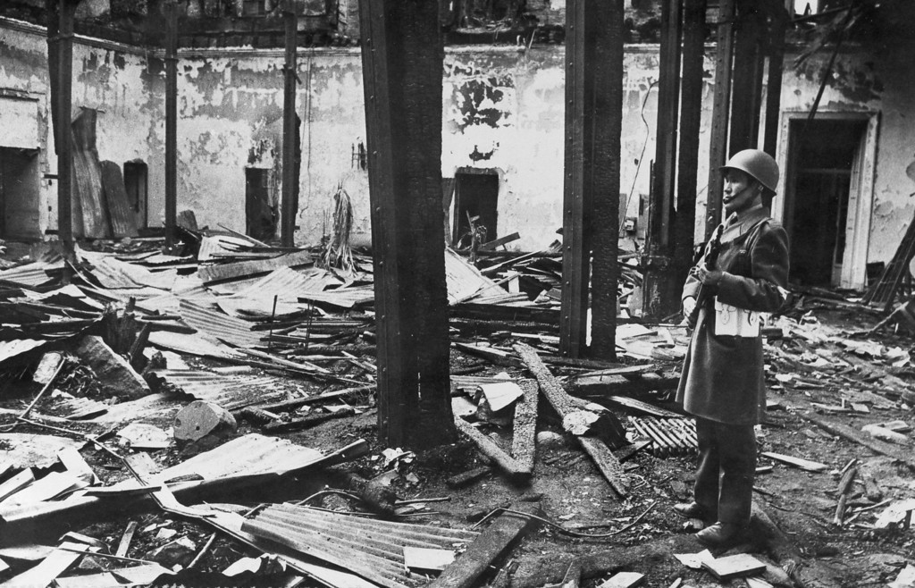 . In this Sept. 29, 1973 file photo, a policeman stands guard inside the bombed out interior of La Moneda, the presidential palace in Santiago, Chile, which was rocketed by jets on Sept. 11, 1973, in a violent military coup against the government of President Salvador Allende. On Wednesday, Sept. 11, 2013, Chile marks the 40th anniversary of the military coup led by Gen. Augusto Pinochet. (AP Photo/File)