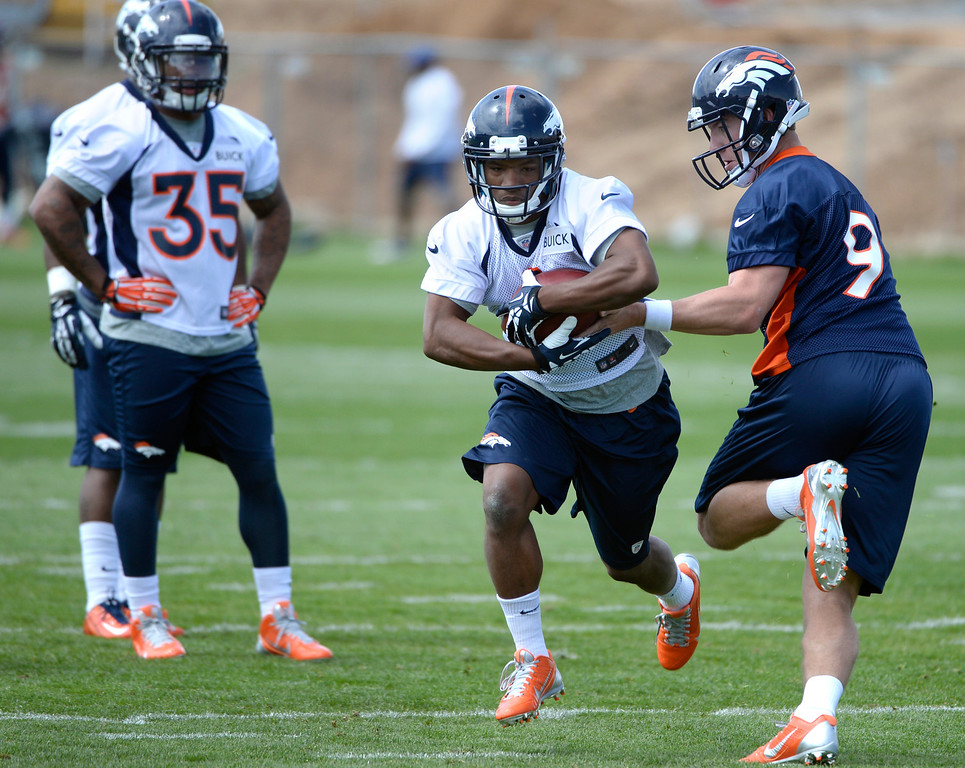 . Damien Thigpen (1) runs through drills with fellow rookies as the Denver Broncos host their rookie minicamp at Dove Valley in Englewood on Friday, May 16, 2014.  (Kathryn Scott Osler, The Denver Post)