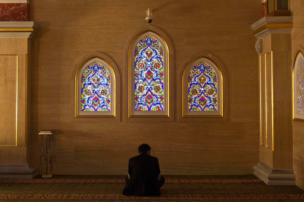 . A Muslim man prays in the Heart of Chechnya Mosque in the Chechen capital Grozny April 26, 2013. The naming of two Chechens, Dzhokhar and Tamerlan Tsarnaev, as suspects in the Boston Marathon bombings has put Chechnya - the former site of a bloody separatist insurgency - back on the world\'s front pages. Chechnya appears almost miraculously reborn. The streets have been rebuilt. Walls riddled with bullet holes are long gone. New high rise buildings soar into the sky. Spotless playgrounds are packed with children. A giant marble mosque glimmers in the night. Yet, scratch the surface and the miracle is less impressive than it seems. Behind closed doors, people speak of a warped and oppressive place, run by a Kremlin-imposed leader through fear.    Picture taken April 26, 2013.   REUTERS/Maxim Shemetov