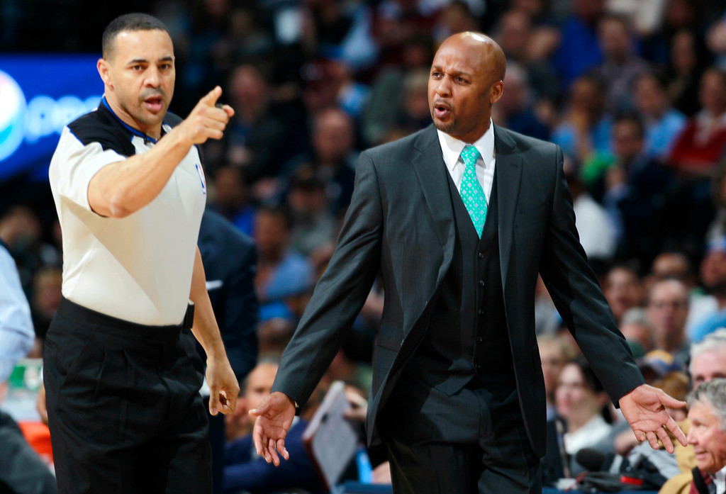 . Denver Nuggets head coach Brian Shaw, right, argues a call against his team with referee Curtis Blair while facing the Washington Wizards in the first quarter of an NBA basketball game on Sunday, March 23, 2014, in Denver. (AP Photo/David Zalubowski)