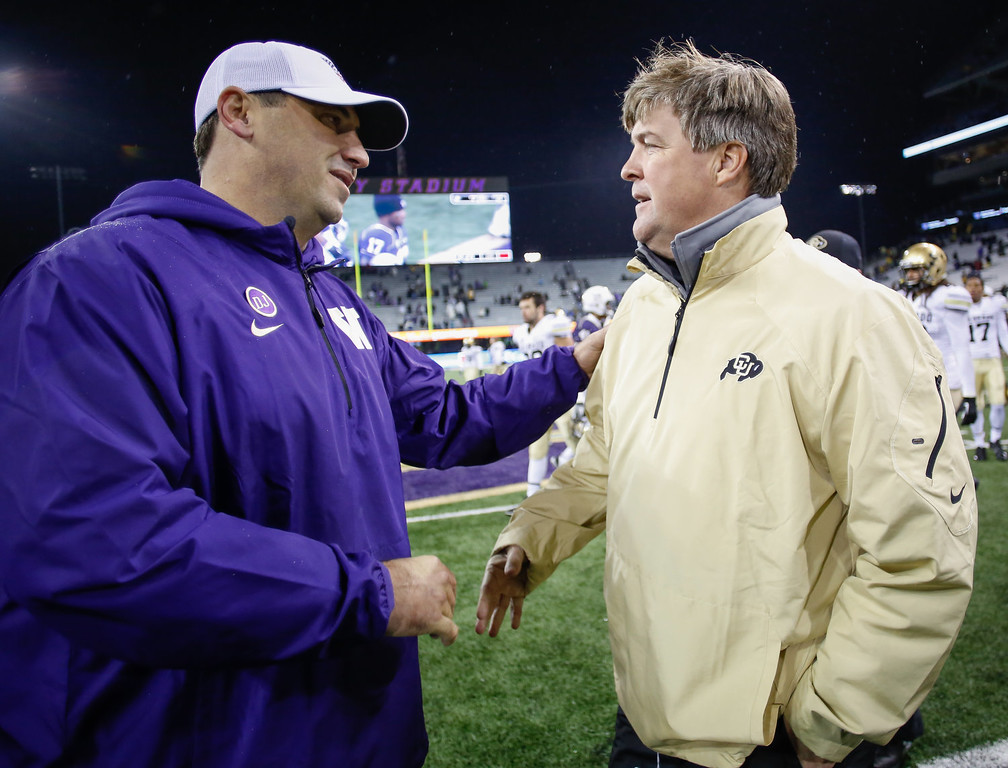 . Head coach Steve Sarkisian (L) of the Washington Huskies is congratulated by head coach Mike MacIntyre of the Colorado Buffaloes after the Huskies defeated the Buffaloes 59-7 on November 9, 2013 at Husky Stadium in Seattle, Washington.  (Photo by Otto Greule Jr/Getty Images)