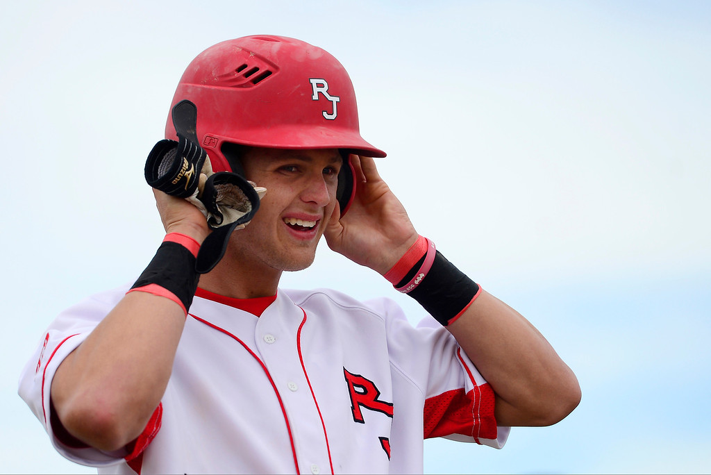. PARKER, CO - APRIL 29: Regis Jesuit shortstop Brody Weiss adjusts his helmet on third base during the team\'s final home game. Weiss is the son of Colorado Rockies manager Walt Weiss. (Photo by AAron Ontiveroz/The Denver Post)