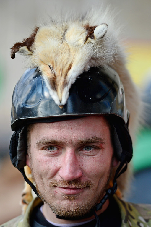 . A man decorates his helmet with a animal as they continue to occupy Independence square, on February 21, 2014 in Kiev, Ukraine.   (Photo by Jeff J Mitchell/Getty Images)