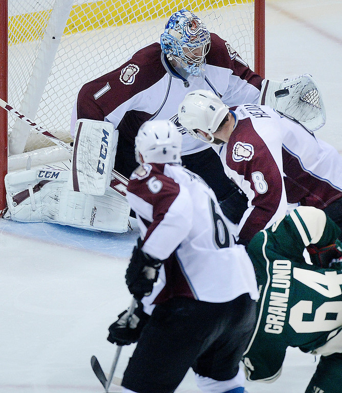 . Colorado goalie Semyon Varlamov made a glove save on a shot from Minnesota center Mikael Granland in the third period.   (Photo by Karl Gehring/The Denver Post)