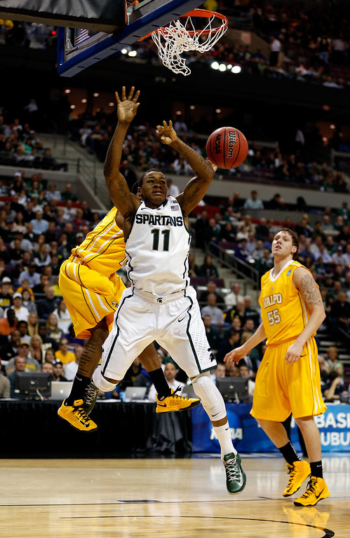 . Keith Appling #11 of the Michigan State Spartans loses the ball as he attempted a shot against Erik Buggs (obscured) #15 of the Valparaiso Crusaders during the second round of the 2013 NCAA Men\'s Basketball Tournament at at The Palace of Auburn Hills on March 21, 2013 in Auburn Hills, Michigan.  (Photo by Gregory Shamus/Getty Images)