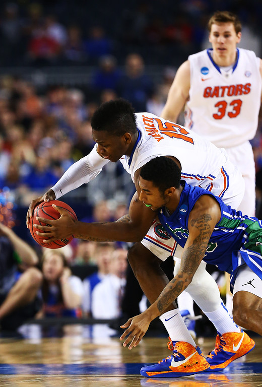 . ARLINGTON, TX - MARCH 29:  Dajuan Graf #35 of the Florida Gulf Coast Eagles attempts to steal from Will Yeguete #15 of the Florida Gators in the first half during the South Regional Semifinal round of the 2013 NCAA Men\'s Basketball Tournament at Dallas Cowboys Stadium on March 29, 2013 in Arlington, Texas.  (Photo by Tom Pennington/Getty Images)