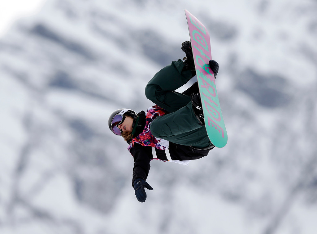. Switzerland\'s Isabel Derungs takes a jump in her first run in the women\'s snowboard slopestyle final at the 2014 Winter Olympics, Sunday, Feb. 9, 2014, in Krasnaya Polyana, Russia. (AP Photo/Andy Wong)