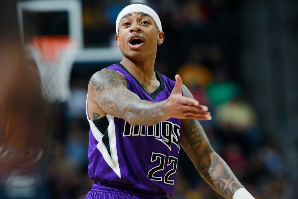 . Sacramento Kings guard Isaiah Thomas directs his teammates as the Kings face the Denver Nuggets in the first quarter of an NBA basketball game in Denver, Sunday, Feb. 23, 2014. (AP Photo/David Zalubowski)