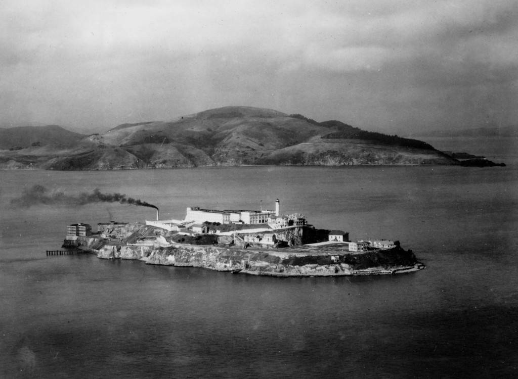 . In this Oct. 12, 1933 file photo, Alcatraz island is seen in San Francisco. At dusk the island prison that housed some of the nation\'s most notorious criminals including James Whitey Bulger and Al Capone is often covered in fog, and the lamps on the grounds emit a ghostly glow.  (AP Photo, file)