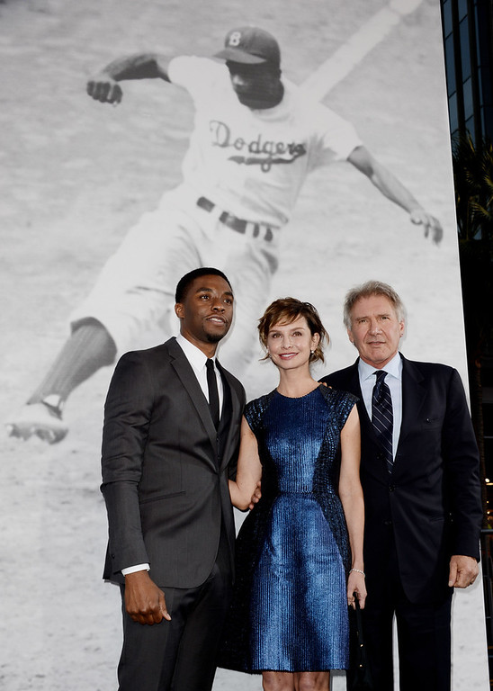 ". Actors Chadwick Boseman, Calista Flockhart and Harrison Ford arrive at the premiere of Warner Bros. Pictures\' and Legendary Pictures\' ""42\"" at the Chinese Theatre on April 9, 2013 in Los Angeles, California.  (Photo by Kevin Winter/Getty Images)"