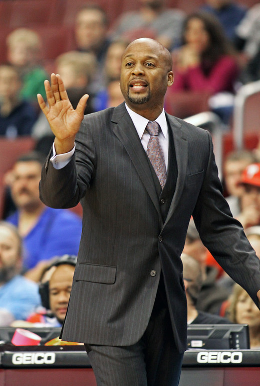 . Denver Nuggets coach Brian Shaw calls a play against the  Philadelphia 76ers in the second half of an NBA basketball game Saturday Dec. 7, 2013, in Philadelphia. The Nuggets won 103-92. (AP Photo/H. Rumph Jr)