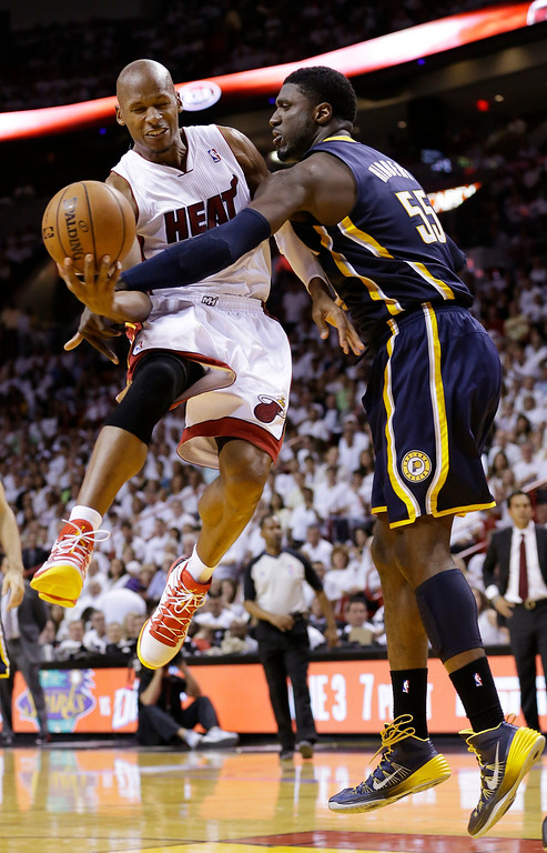 . Indiana Pacers center Roy Hibbert (55) blocks a shot to the basket by Miami Heat guard Ray Allen during the second half of Game 4 in the NBA basketball Eastern Conference finals playoff series, Monday, May 26, 2014, in Miami. (AP Photo/Wilfredo Lee)