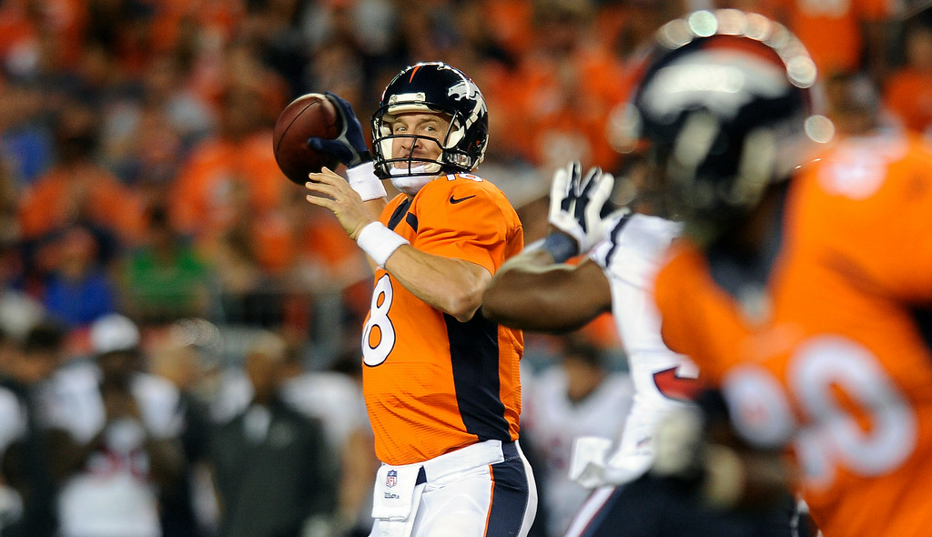 . DENVER, CO - AUGUST 23: Quarterback Peyton Manning sees an open Julius Thomas in the second quarter of the preseason game against the Houston Texans at Sports Authority Field at Mile High on Saturday, August 23, 2014 in Denver, Colorado.  (Photo by Steve Nehf/The Denver Post)