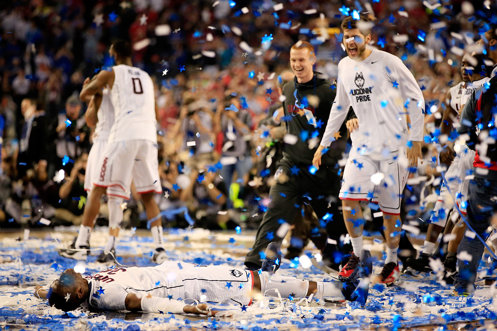 . ARLINGTON, TX - APRIL 07: Amida Brimah #35 of the Connecticut Huskies celebrates after defeating the Kentucky Wildcats 60-54 in the NCAA Men\'s Final Four Championship at AT&T Stadium on April 7, 2014 in Arlington, Texas.  (Photo by Jamie Squire/Getty Images)