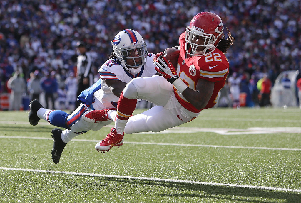 . Dexter McCluster #22 of the Kansas City Chiefs is tackled after making the catch during NFL game action by Nickell Robey #37 of the Buffalo Bills at Ralph Wilson Stadium on November 3, 2013 in Orchard Park, New York. (Photo by Tom Szczerbowski/Getty Images)