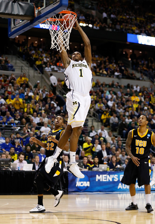 . AUBURN HILLS, MI - MARCH 23:  Glenn Robinson III #1 of the Michigan Wolverines dunks in the second half against the Virginia Commonwealth Rams during the third round of the 2013 NCAA Men\'s Basketball Tournament at The Palace of Auburn Hills on March 23, 2013 in Auburn Hills, Michigan.  (Photo by Gregory Shamus/Getty Images)