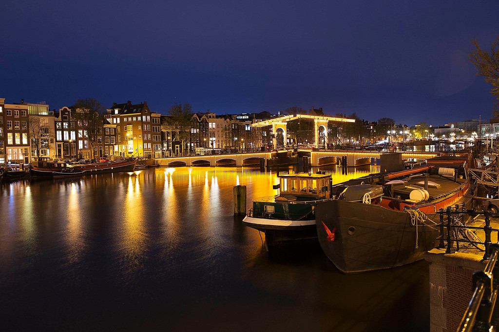 . Nightview of the Magere Brug, the skinny bridge,the most famous bridge in Amsterdam April 22, 2013. The Royal celebrations in the Netherlands this week put the country and the capital Amsterdam on front pages and television screens around the world with an orange splash. There\'s plenty to see and do in 48 hours in this compact city, where the world-famous Rijksmuseum only recently reopened after an extensive renovation. Picture taken April 22, 2013. REUTERS/Michael Kooren