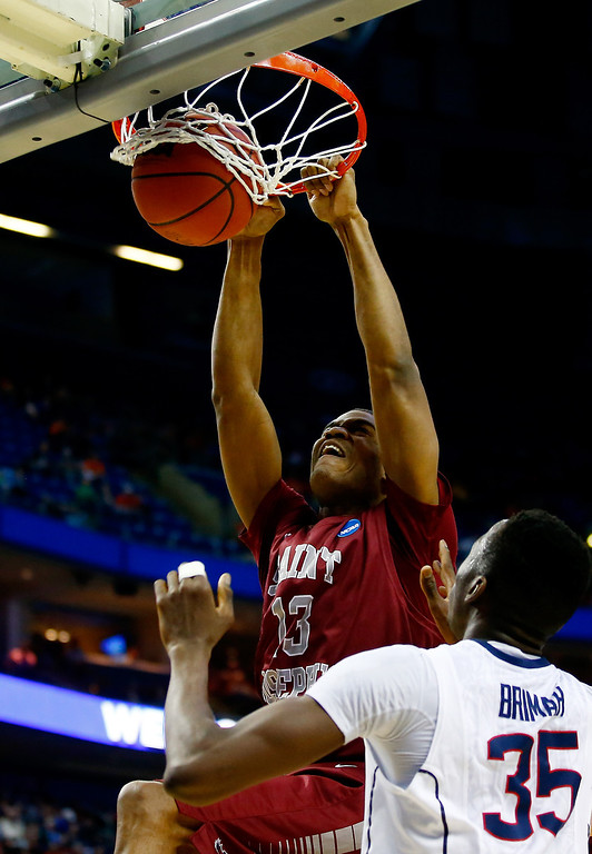 . BUFFALO, NY - MARCH 20: Ronald Roberts, Jr. #13 of the Saint Joseph\'s Hawks dunks against the Connecticut Huskies during the second round of the 2014 NCAA Men\'s Basketball Tournament at the First Niagara Center on March 20, 2014 in Buffalo, New York.  (Photo by Jared Wickerham/Getty Images)