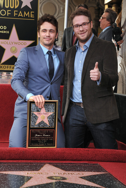 . Actor James Franco, left, poses with Seth Rogen at a ceremony honoring Franco with a star on the Hollywood Walk of Fame on Thursday, March 7, 2013 in Los Angeles.  (Photo by John Shearer/Invision/AP)