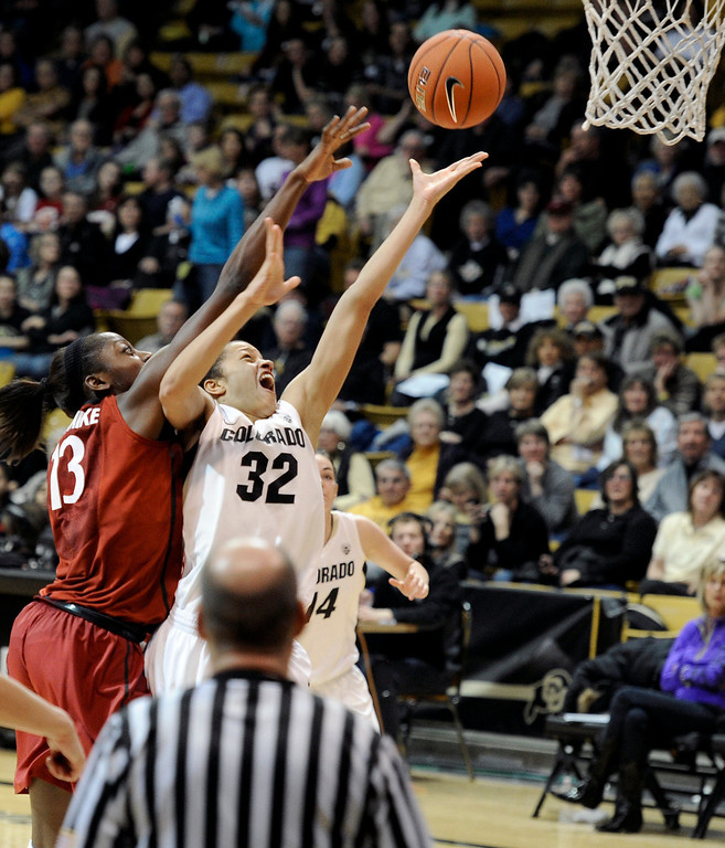 . University of Colorado\'s Arielle Roberson goes for a lay-up under the hands of Chiney Ogwumike during a game against Stanford on Friday, Jan. 4, at the Coors Event Center on the CU campus in Boulder.    Jeremy Papasso/Camera