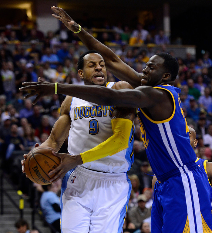 . Denver Nuggets shooting guard Andre Iguodala (9) tries to drive around Golden State Warriors small forward Draymond Green (23). The Denver Nuggets took on the Golden State Warriors in Game 5 of the Western Conference First Round Series at the Pepsi Center in Denver, Colo. on April 30, 2013. (Photo by AAron Ontiveroz/The Denver Post)