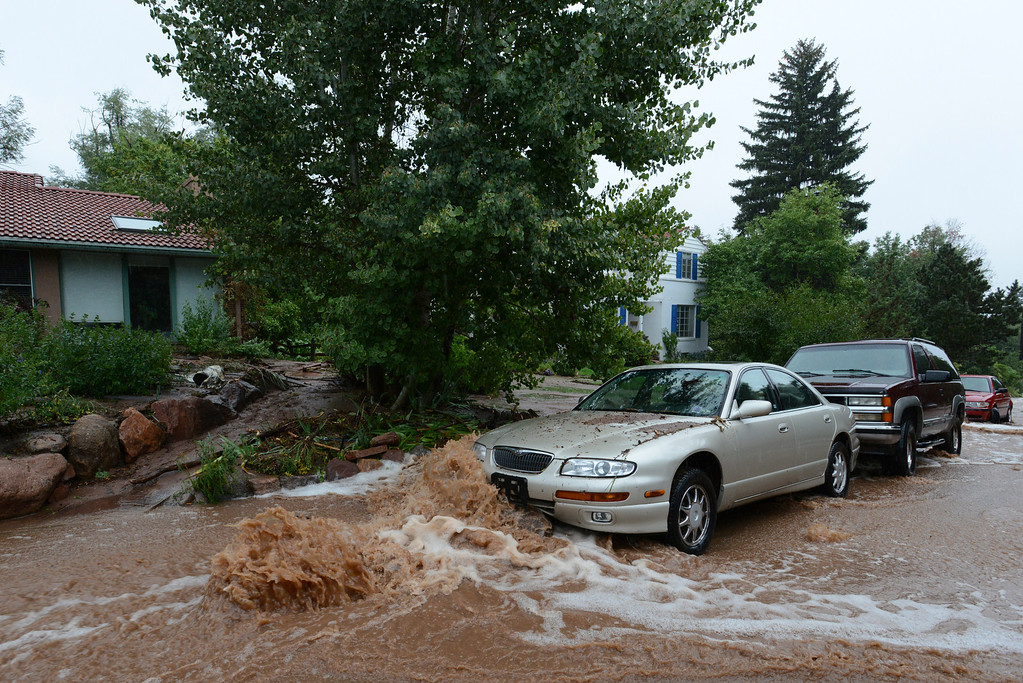 . Cars are hit by flood waters  Mariposa Ave. and 18th in Boulder on Thursday. September 12, 2013 staff photo/ David R. Jennings