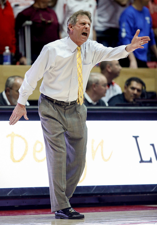 . Wyoming coach Larry Shyatt yells to his players during the first half of an NCAA college basketball game against New Mexico in Albuquerque, N.M., Saturday, March 2, 2013. (AP Photo/ Craig Fritz)
