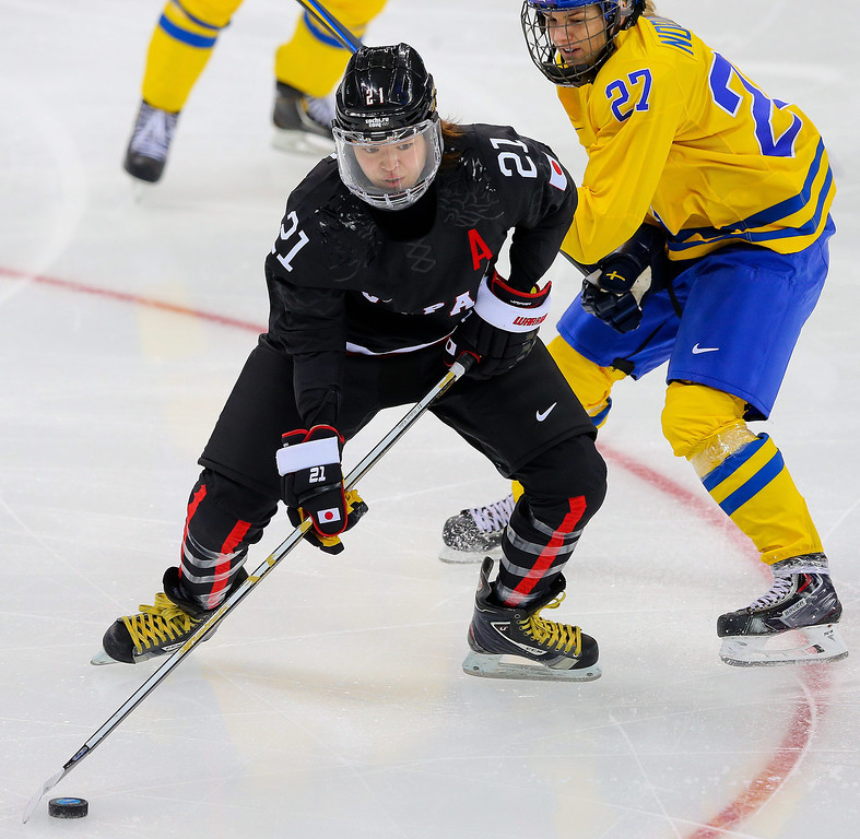 . Hanae Kubo (L) of Japan in action agaist Emma Nordin (R) of Sweden during the match between Sweden and Japan at the Shayba Arena in the Ice Hockey tournament at the Sochi 2014 Olympic Games, Sochi, Russia, 09 February 2014  EPA/SRDJAN SUKI