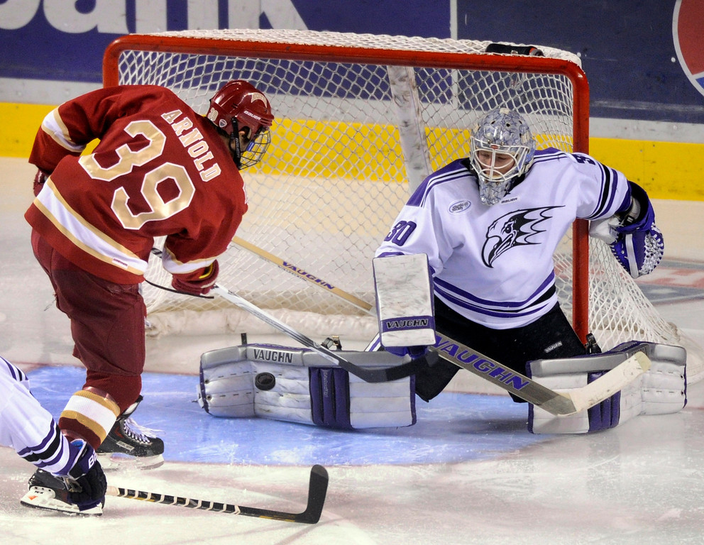 . DENVER, CO. - OCTOBER 25: Denver right wing Grant Arnold (39) put a shot on net in the second period. The University of Denver hockey team hosted Niagara at Magness Arena Friday night, October 25, 2013. Photo By Karl Gehring/The Denver Post