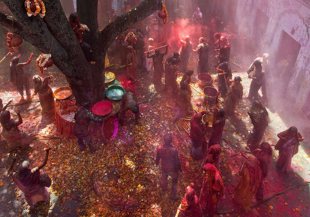 . Indian widows celebrate Holi with water and gulal (colored powder) in Vrindavan on March 14, 2014. B AFP PHOTO/Prakash SINGH/AFP/Getty Images