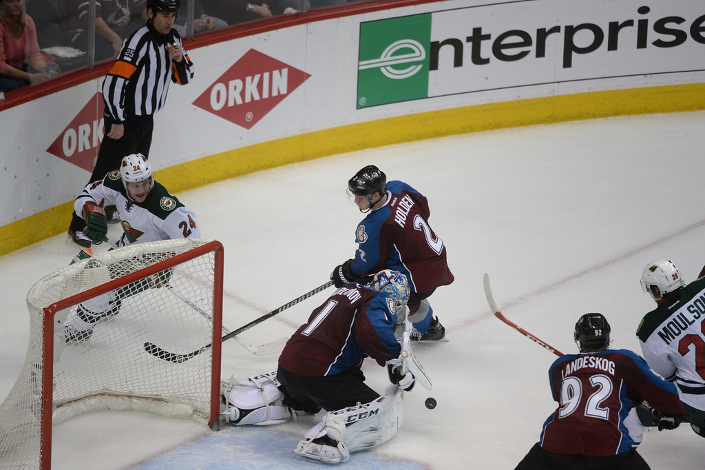 . Semyon Varlamov (1) of the Colorado Avalanche makes a save during the second period of action. The Colorado Avalanche hosted the Minnesota Wild in the first round of the Stanley Cup Playoffs at the Pepsi Center in Denver, Colorado on Saturday, April 19, 2014. (Photo by Karl Gehring/The Denver Post)