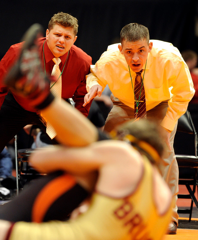 . DENVER, CO. - FEBRUARY 21: Brush coaches J.J. Pursley, left and Troy Lussenhop, right, reacted as sophomore wrestler Conrad Cole took on Monte Vista opponent Jose Duran in a semifinal match in class 3A, at 113-pounds. The CHSAA State Wrestling Tournament continued Friday, February 22, 2013 with quarterfinal and semifinal matches at the Pepsi Center in Denver. (Photo By Karl Gehring/The Denver Post)