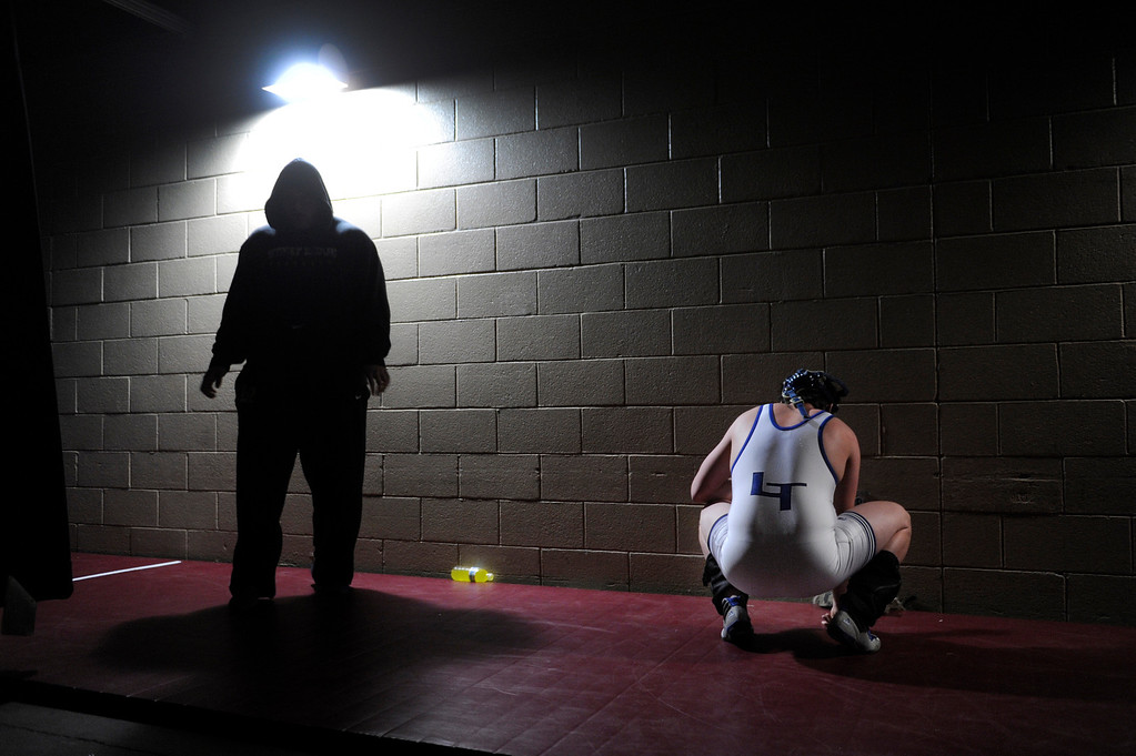. DENVER, CO. - FEBRUARY 21: Wrestlers warmed up in a Pepsi Center hallway prior to consolation round matches Friday afternoon. The CHSAA State Wrestling Tournament continued Friday, February 22, 2013 with quarterfinal and semifinal matches at the Pepsi Center in Denver. (Photo By Karl Gehring/The Denver Post)