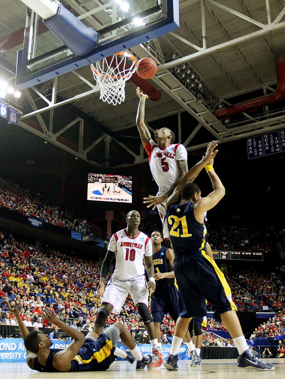 . LEXINGTON, KY - MARCH 21:  Kevin Ware #5 of the Louisville Cardinals goes to the hoop against R.J. Buck #21 of the North Carolina A&T Aggies during the second round of the 2013 NCAA Men\'s Basketball Tournament at the Rupp Arena on March 21, 2013 in Lexington, Kentucky.  (Photo by Andy Lyons/Getty Images)