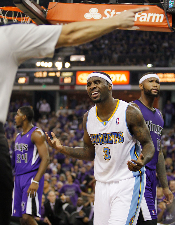 . Denver Nuggets point guard Ty Lawson (3) reacts after a referee makes a call during the fourth quarter of an NBA basketball game against the Sacramento Kings, Wednesday, Oct. 30, 2013, in Sacramento, Calif. The Kings won 90-88. (AP Photo/Genevieve Ross)