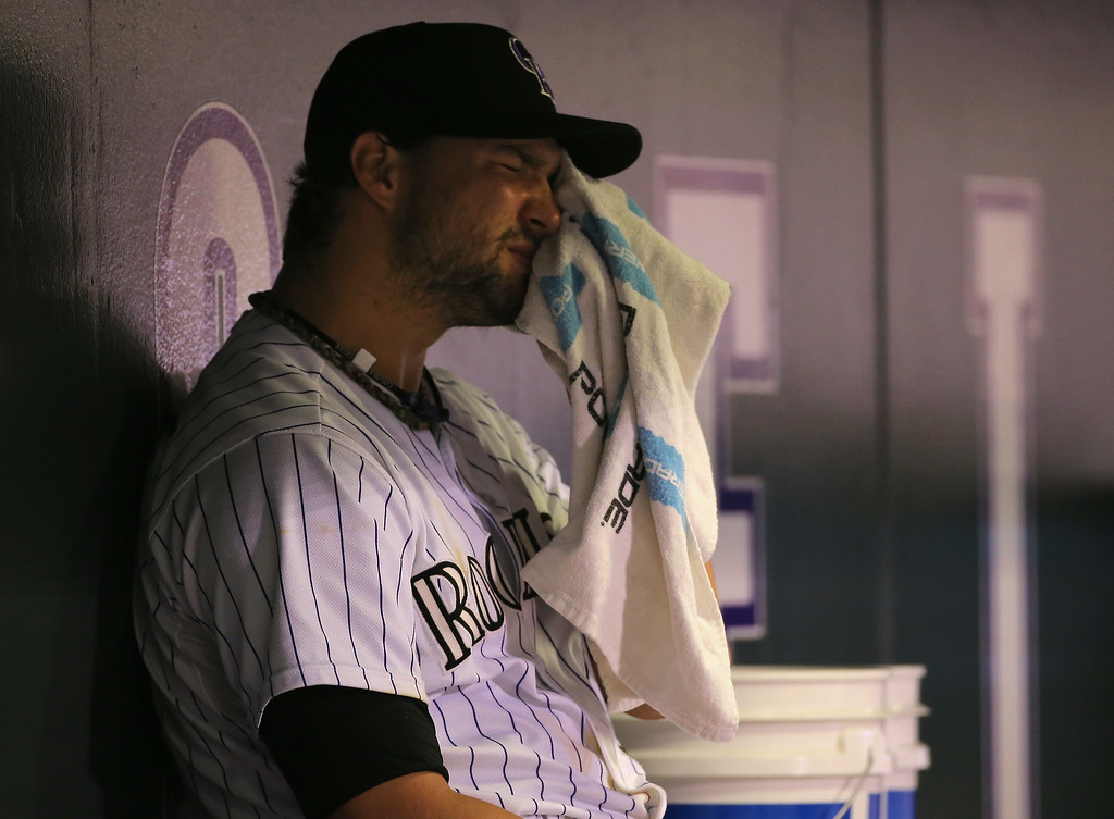 . DENVER, CO - AUGUST 05:  Relief pitcher Tommy Kahnle #54 of the Colorado Rockies returns to the dugout after being removed from the game against the Chicago Cubs in the seventh inning at Coors Field on August 5, 2014 in Denver, Colorado.  (Photo by Doug Pensinger/Getty Images)