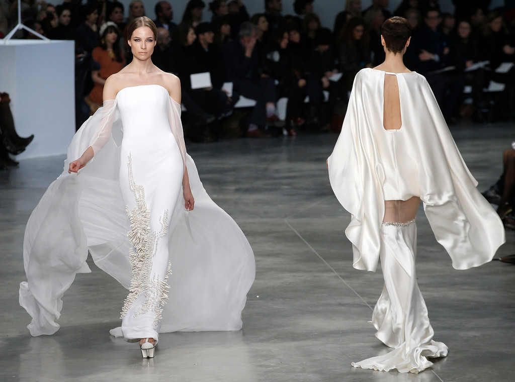 . Models present creations by French fashion designer Stephane Rolland  for his Spring Summer 2013 Haute Couture fashion collection, presented in Paris, Tuesday, Jan.22, 2013. (AP Photo/Christophe Ena)