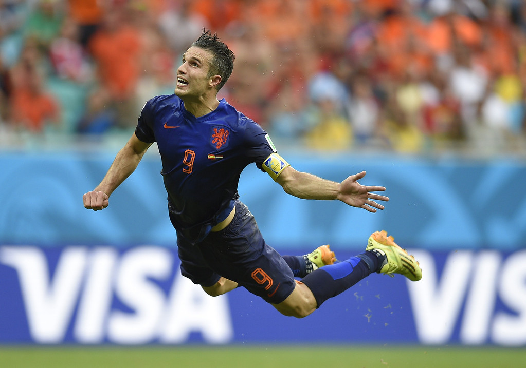 . Netherlands\' forward Robin van Persie scores during a Group B football match between Spain and the Netherlands at the Fonte Nova Arena in Salvador during the 2014 FIFA World Cup on June 13, 2014. LLUIS GENE/AFP/Getty Images