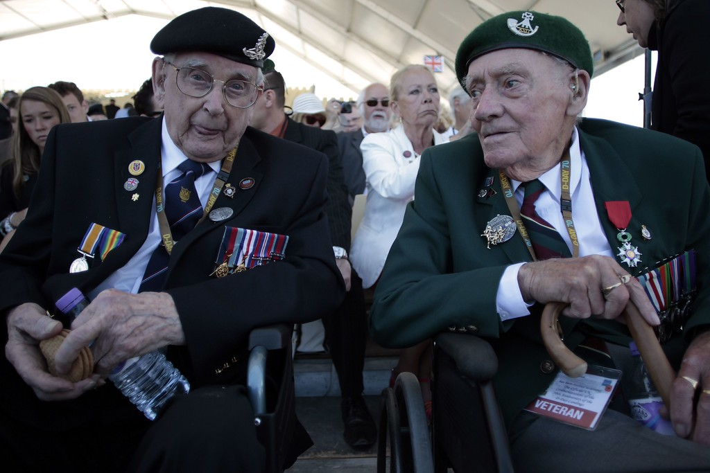 . British veterans sit prior to an international D-Day commemoration ceremony on the beach of Ouistreham, Normandy, on June 6, 2014, marking the 70th anniversary of the World War II Allied landings in Normandy.  AFP PHOTO / CHARLY TRIBALLEAU/AFP/Getty Images